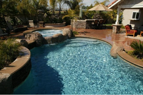 Pebble Pools http://amazingpools.net/new_residential_pool_construction.htm